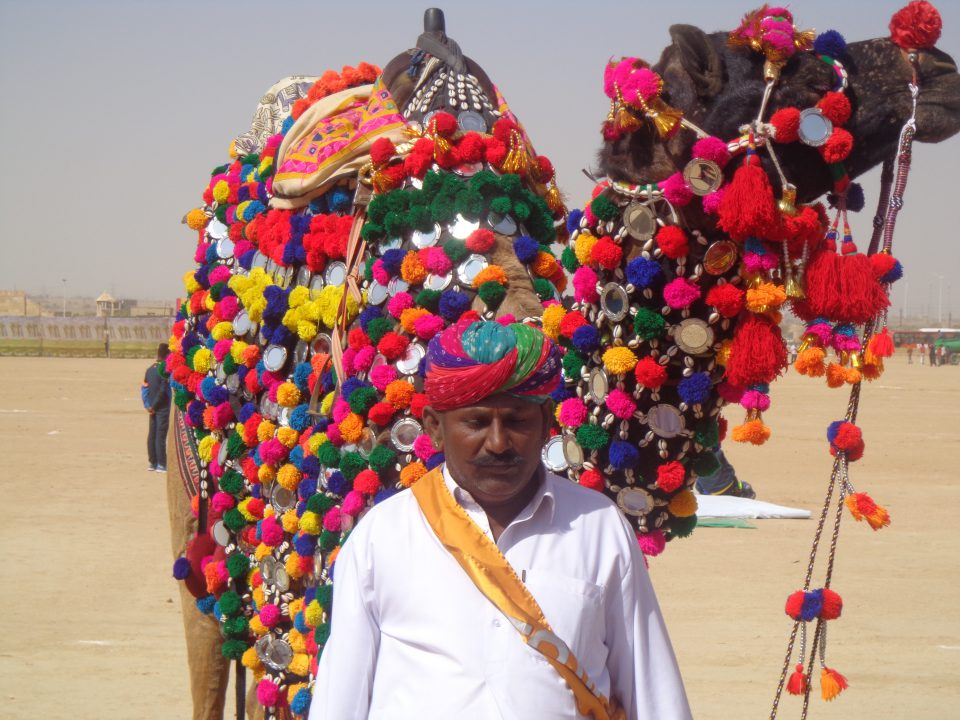 Mithun Chakravarty the winner of the best camel competition with trainer Chena Ram