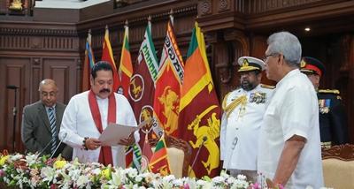 Mahida Rajapakshya being sworn in as the PM